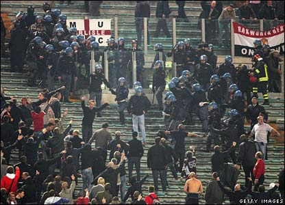 Manchester United fans taking a beating in Rome